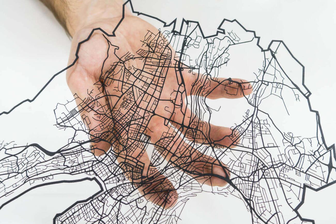 Lasercut street network of zurich in paper by Robin Hanhart