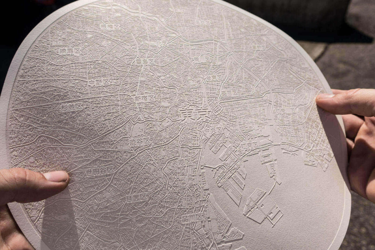 Size in hand of the laser engraved paper map of Tokyo, Japan. By Robin Hanhart